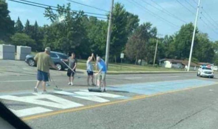 This Is America – Cops Protect People Painting Over A BLM Street Mural (Video)