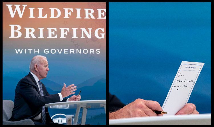 """Photo: Biden Holds A Card Handed To Him By An Aide That Reads """"Sir, There Is Something On Your Chin"""" – Joe Is Reading The Other Side"""